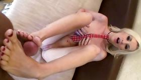 Blonde slut doing the foot job on a sick